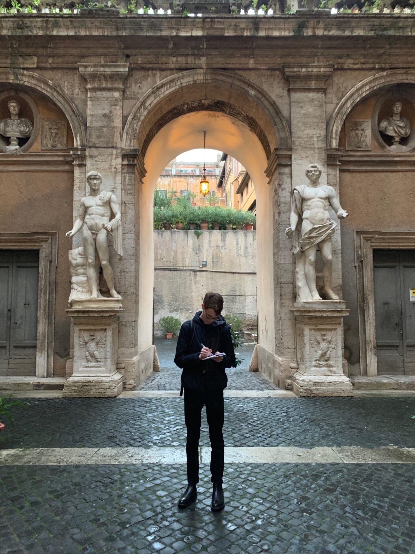 Noah Baker sketches at Palazzo Mattei.
